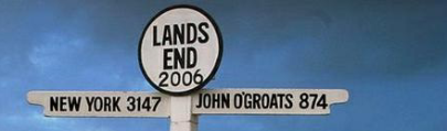 A sign post in Lands end, New York 3147 miles and John o'Groats 874 miles.