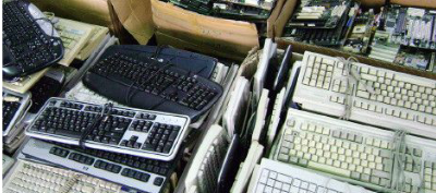 Various office keyboards and equipment that need to be cleared.