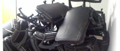 A pile of old office chairs.